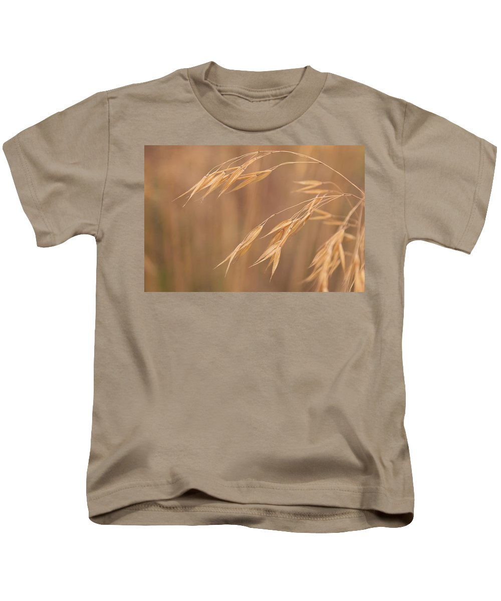 Stipa Kids T-Shirt featuring the photograph Grass In The Wind by Monika Tymanowska