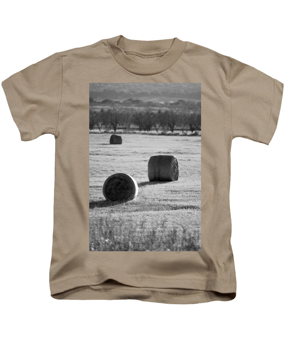 Black And White Kids T-Shirt featuring the photograph Hay Is For Horses by Jill Reger