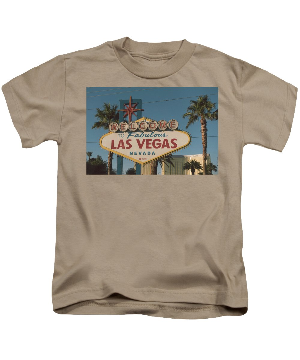 Sign Kids T-Shirt featuring the photograph Las Vegas Welcome Sign With Vegas Strip In Background by Alex Grichenko