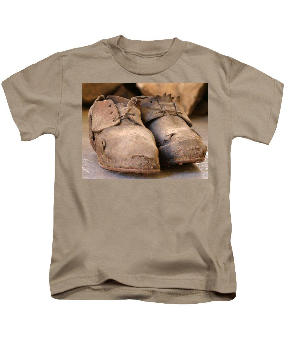 Mining Kids T-Shirt featuring the photograph Mining Shoes Langban Sweden by Dagmar Batyahav