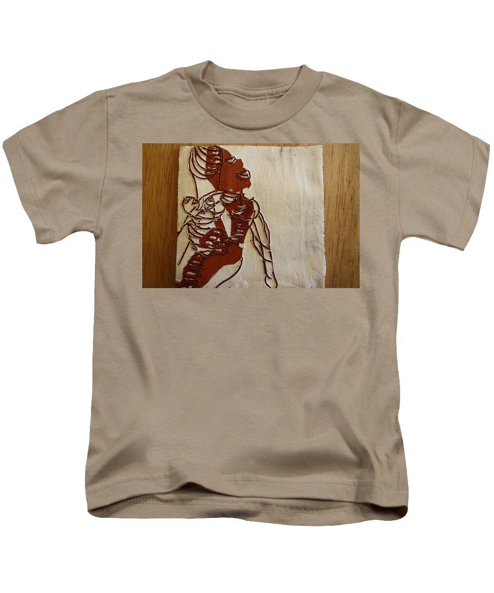 Jesus Kids T-Shirt featuring the ceramic art Mums Bliss - Tile by Gloria Ssali