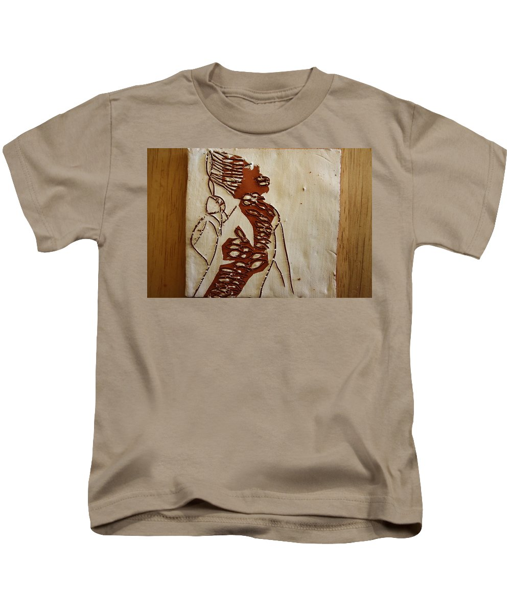 Jesus Kids T-Shirt featuring the ceramic art Mums Home - Tile by Gloria Ssali