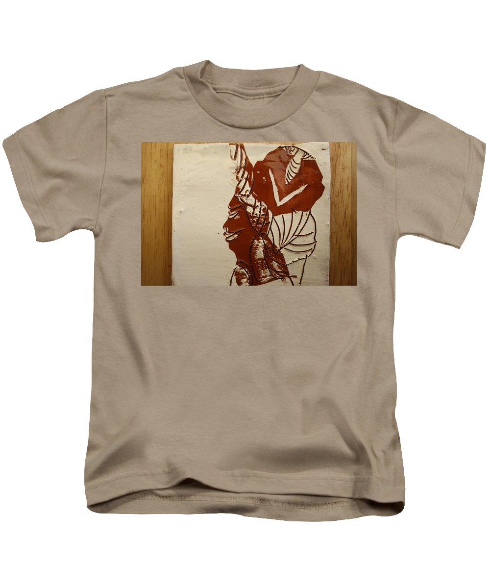 Jesus Kids T-Shirt featuring the ceramic art Mums Love - Tile by Gloria Ssali