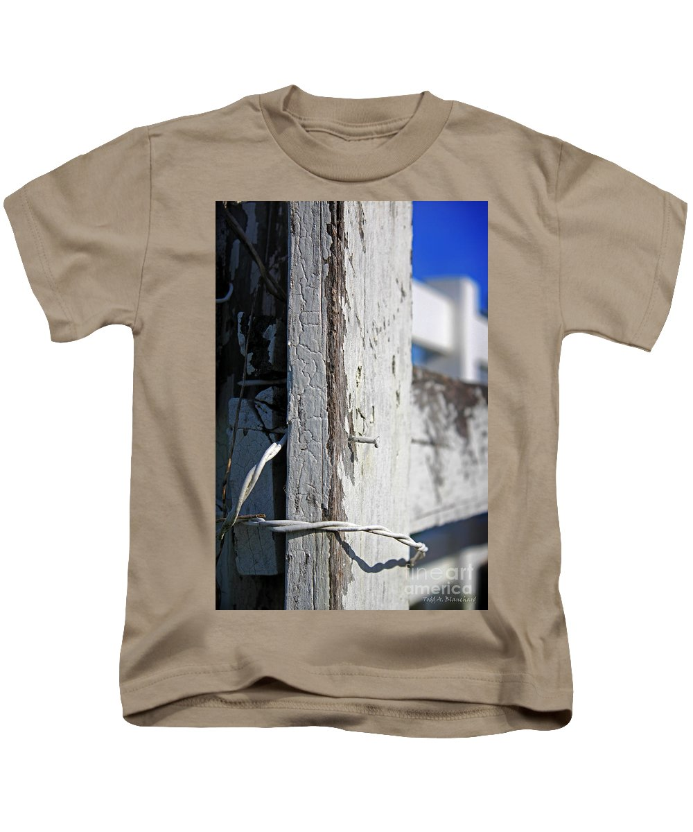 Abstract Kids T-Shirt featuring the photograph Old Fence Post by Todd Blanchard