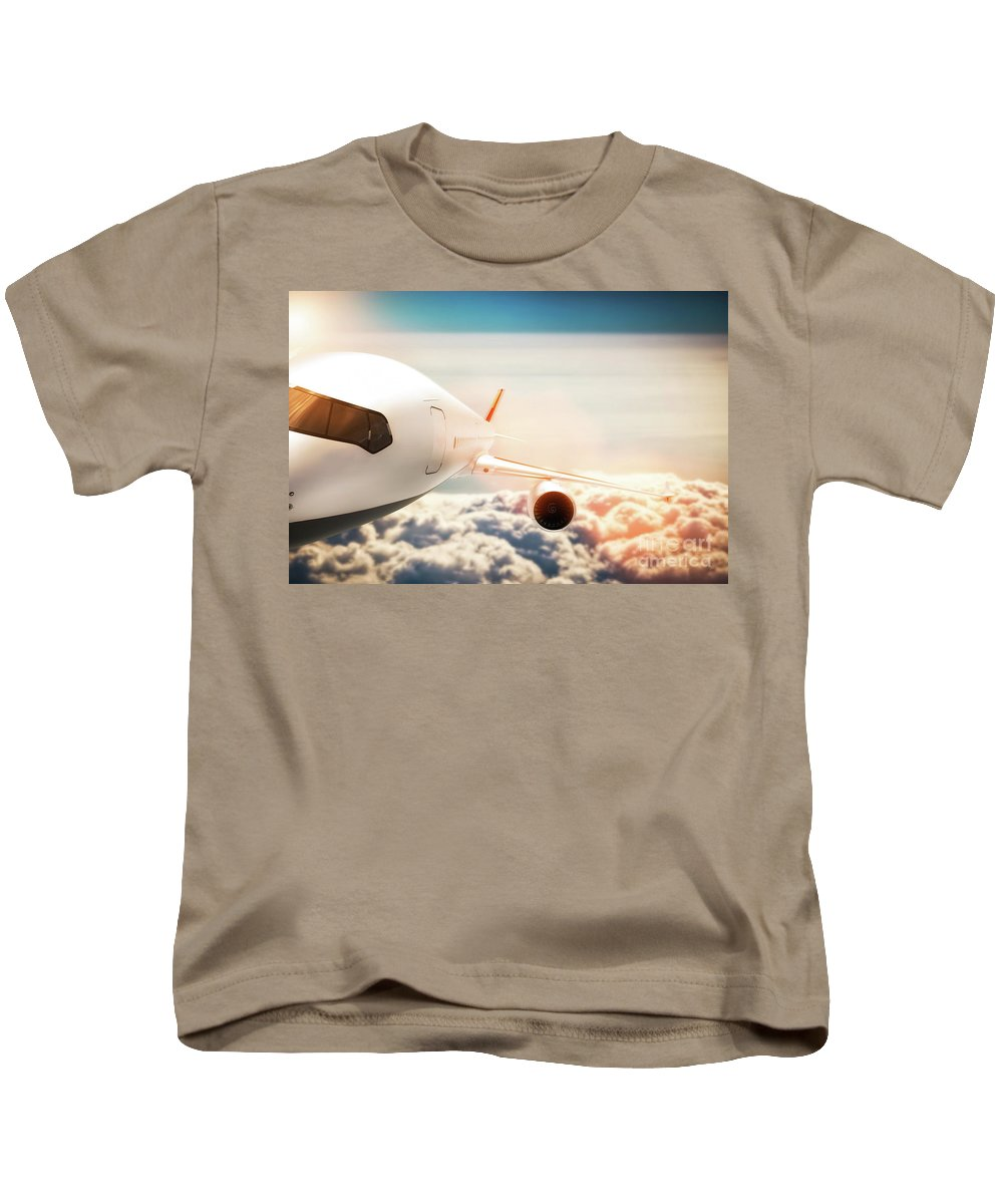 Airplane Kids T-Shirt featuring the photograph Passenger Airplane Flying At Sunshine, Blue Sky. by Michal Bednarek