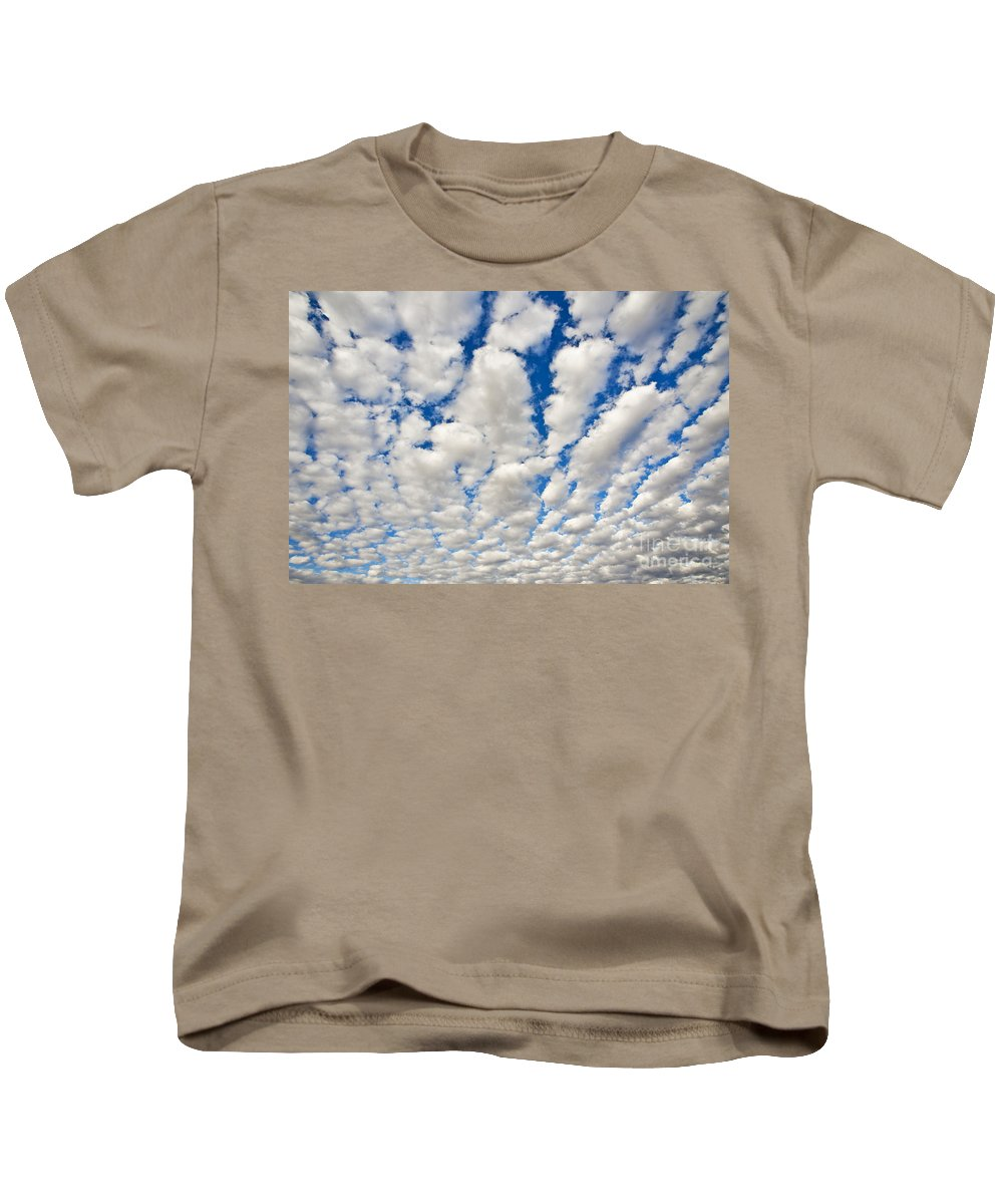Above Kids T-Shirt featuring the photograph Puffy Clouds And Blue Sky by Bill Brennan - Printscapes