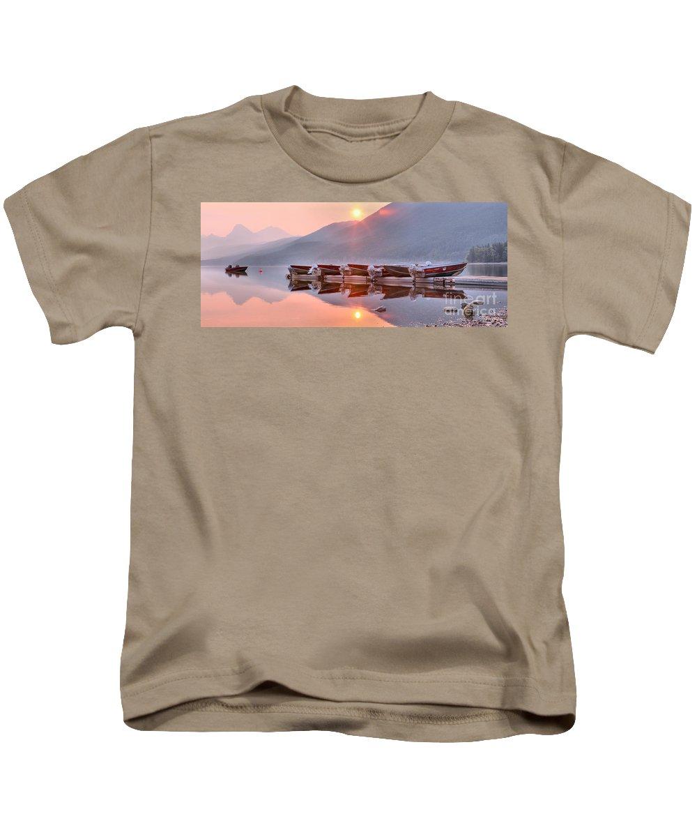Lake Mcdonald Kids T-Shirt featuring the photograph Sun Through Smoke At Mcdonald by Adam Jewell