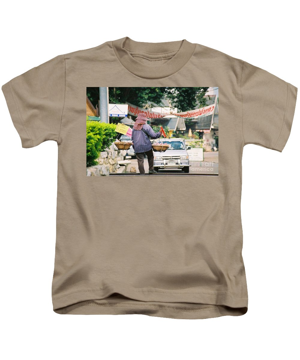 Sales Kids T-Shirt featuring the photograph Vendor by Mary Rogers