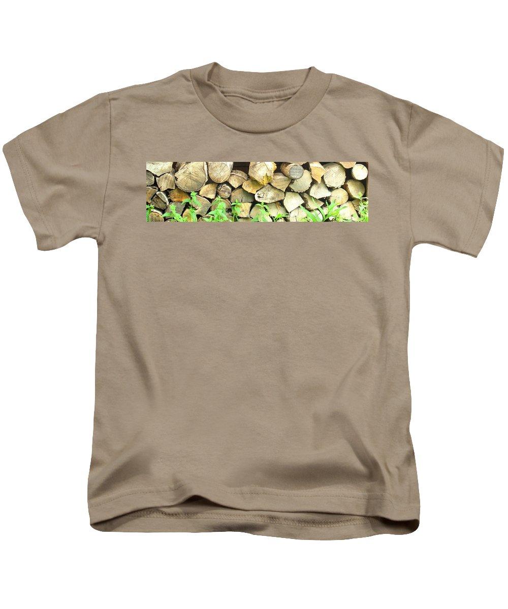 Wood Kids T-Shirt featuring the photograph Wood Pile by Ian MacDonald