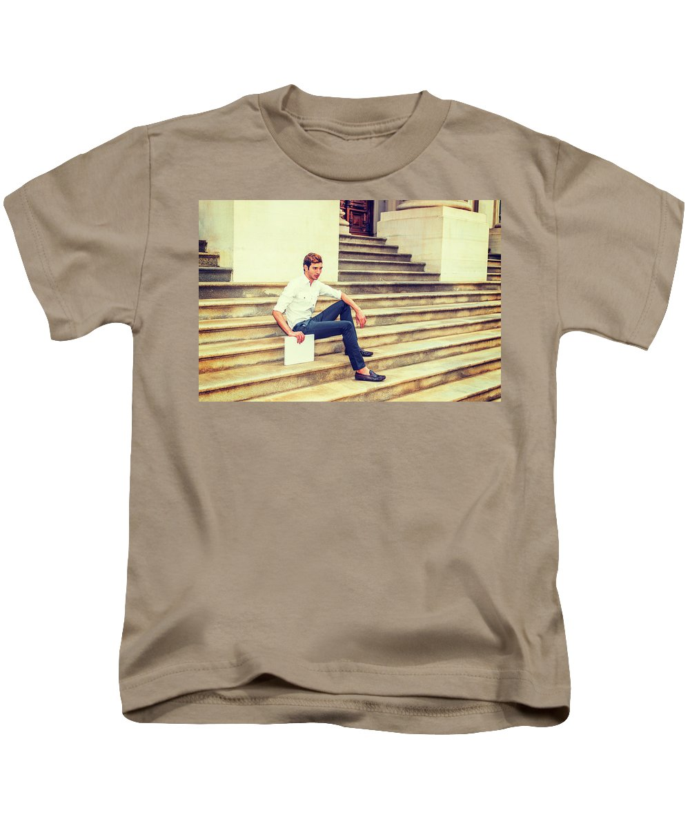 Young Kids T-Shirt featuring the photograph Young Businessman Sitting On Stairs, Relaxing Outside by Alexander Image