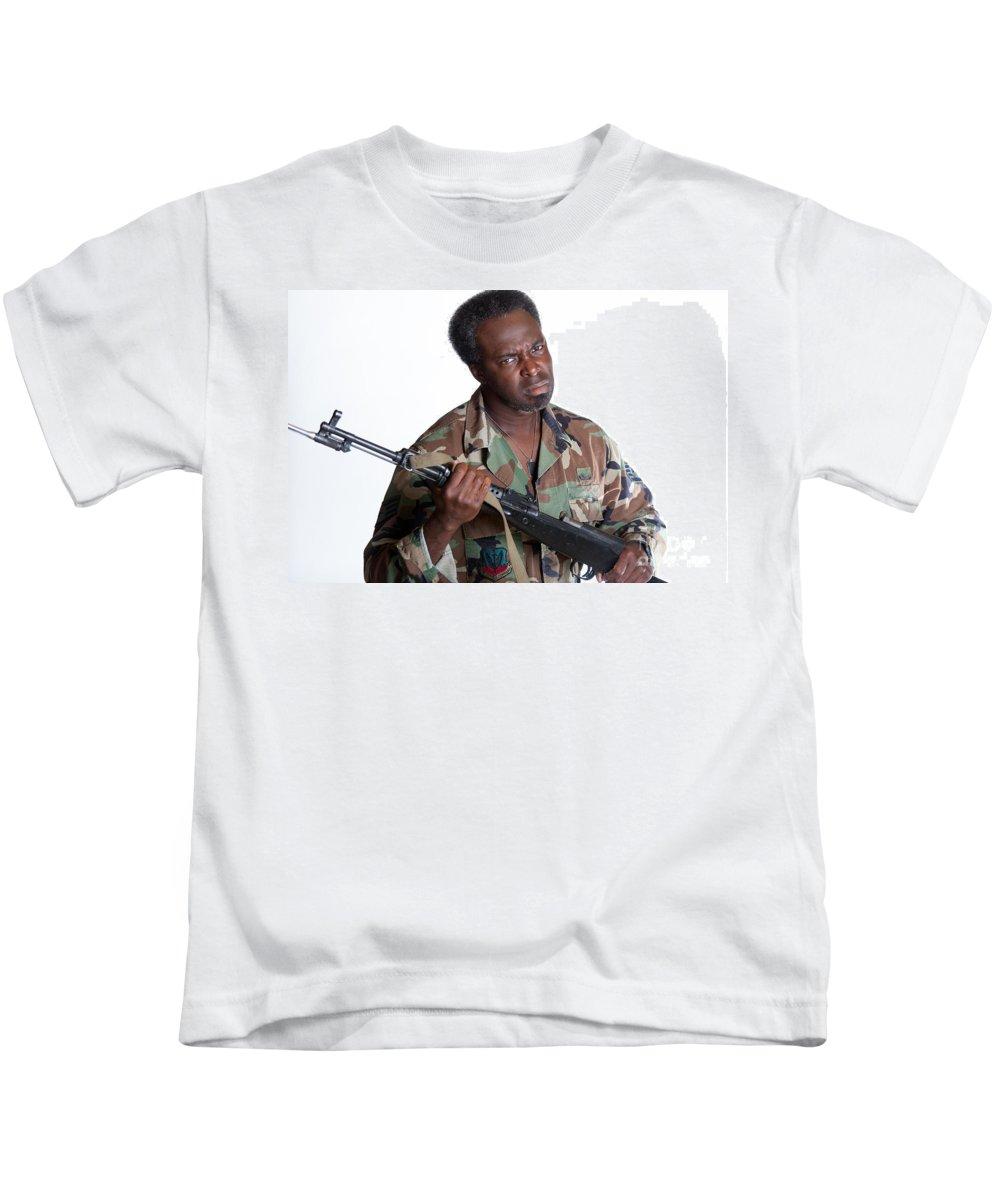 Action Kids T-Shirt featuring the photograph African American Man With Gun by Gunter Nezhoda