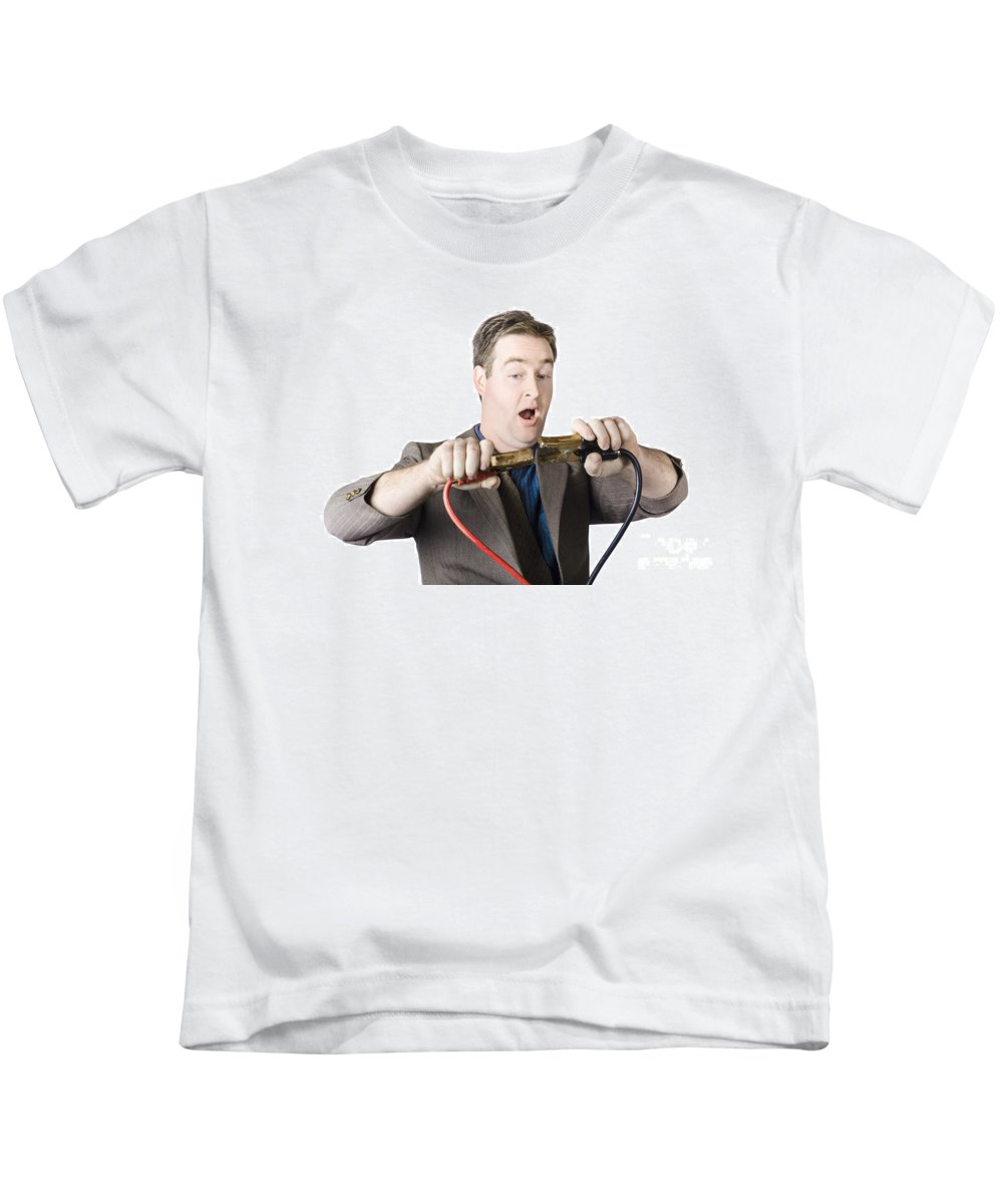 Businessman Kids T-Shirt featuring the photograph Businessman About To Connect Jumper Cable by Jorgo Photography - Wall Art Gallery