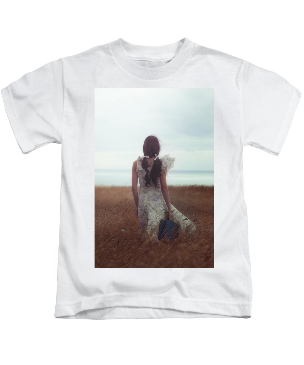 Girl Kids T-Shirt featuring the photograph Girl With Suitcase by Joana Kruse
