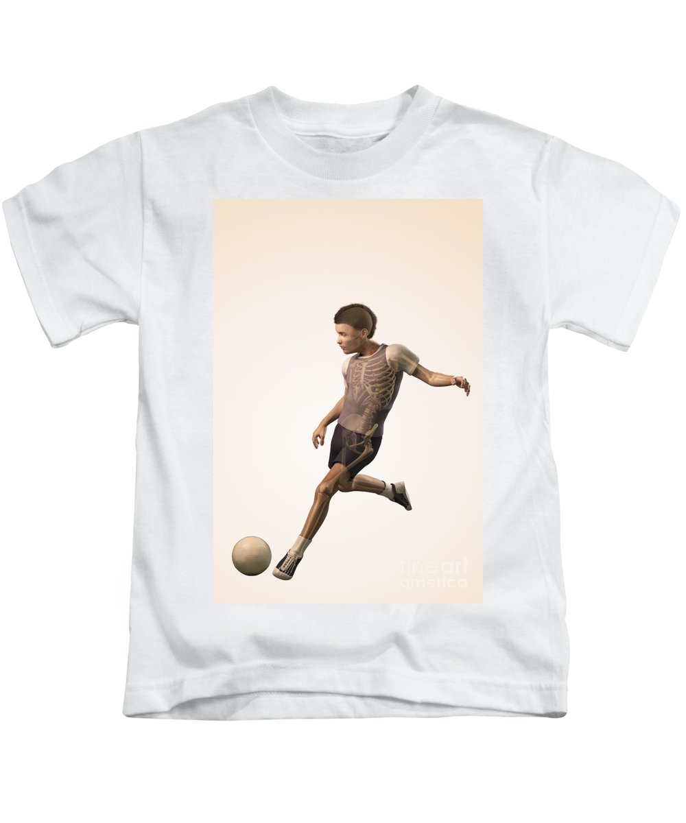 Kick Kids T-Shirt featuring the photograph Anatomy Of Movement Child by Science Picture Co