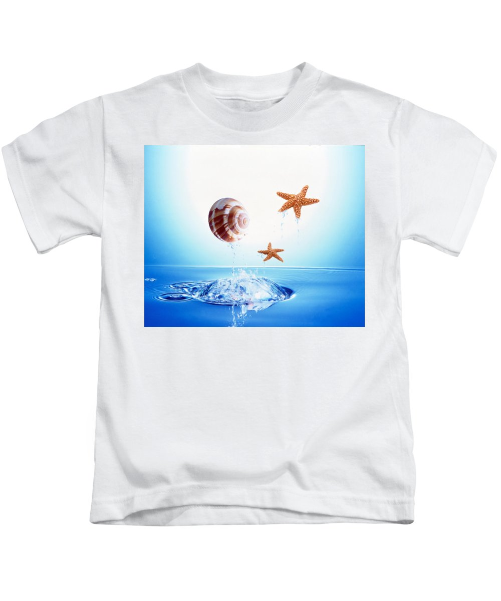 Photography Kids T-Shirt featuring the photograph A Shell And Two Starfish Floating by Panoramic Images