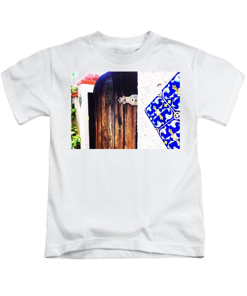 Door Kids T-Shirt featuring the photograph Blue Tile Brown Door 1 by Korynn Neil