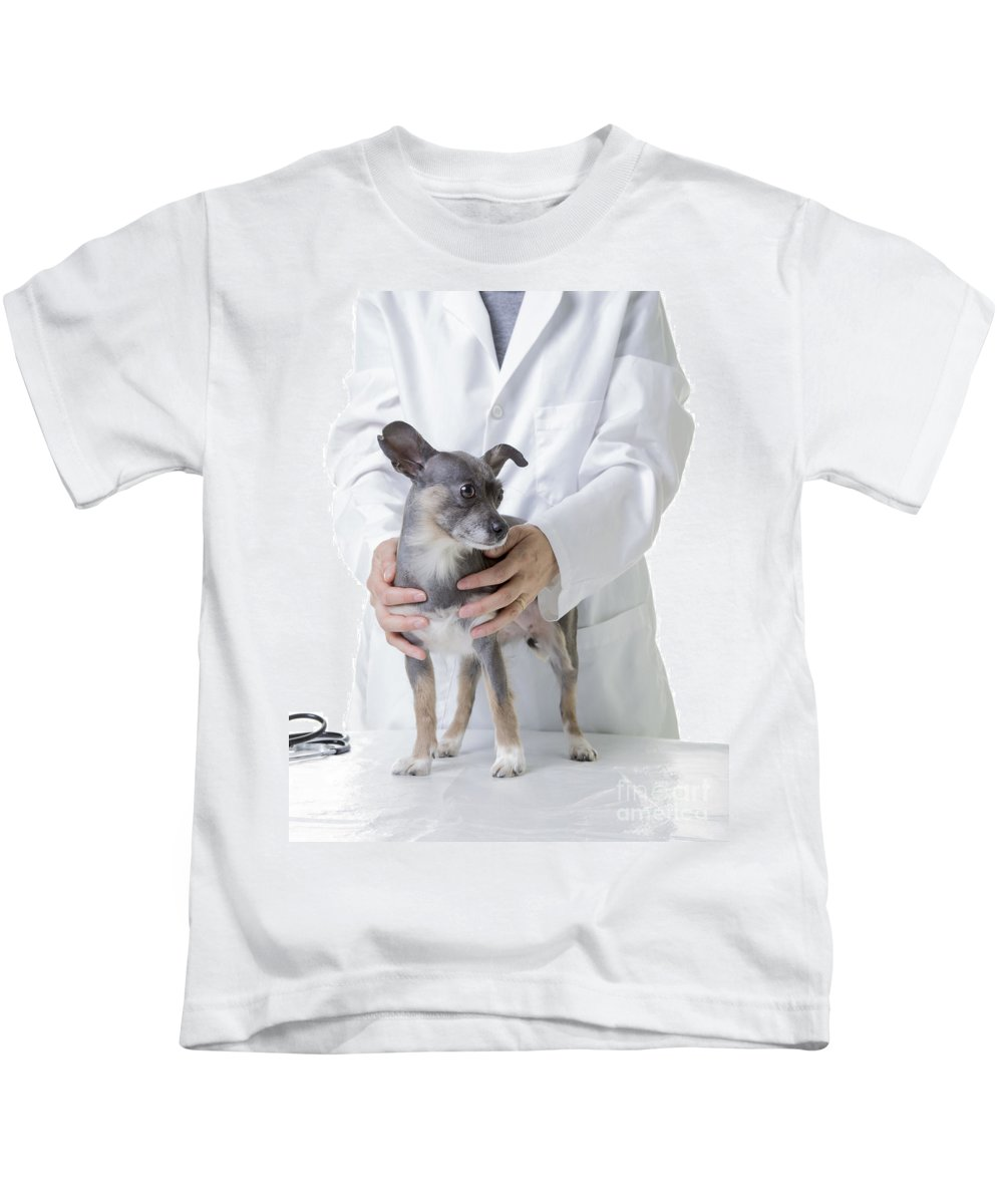 Dog Kids T-Shirt featuring the photograph Cute Little Dog At The Vet by Edward Fielding