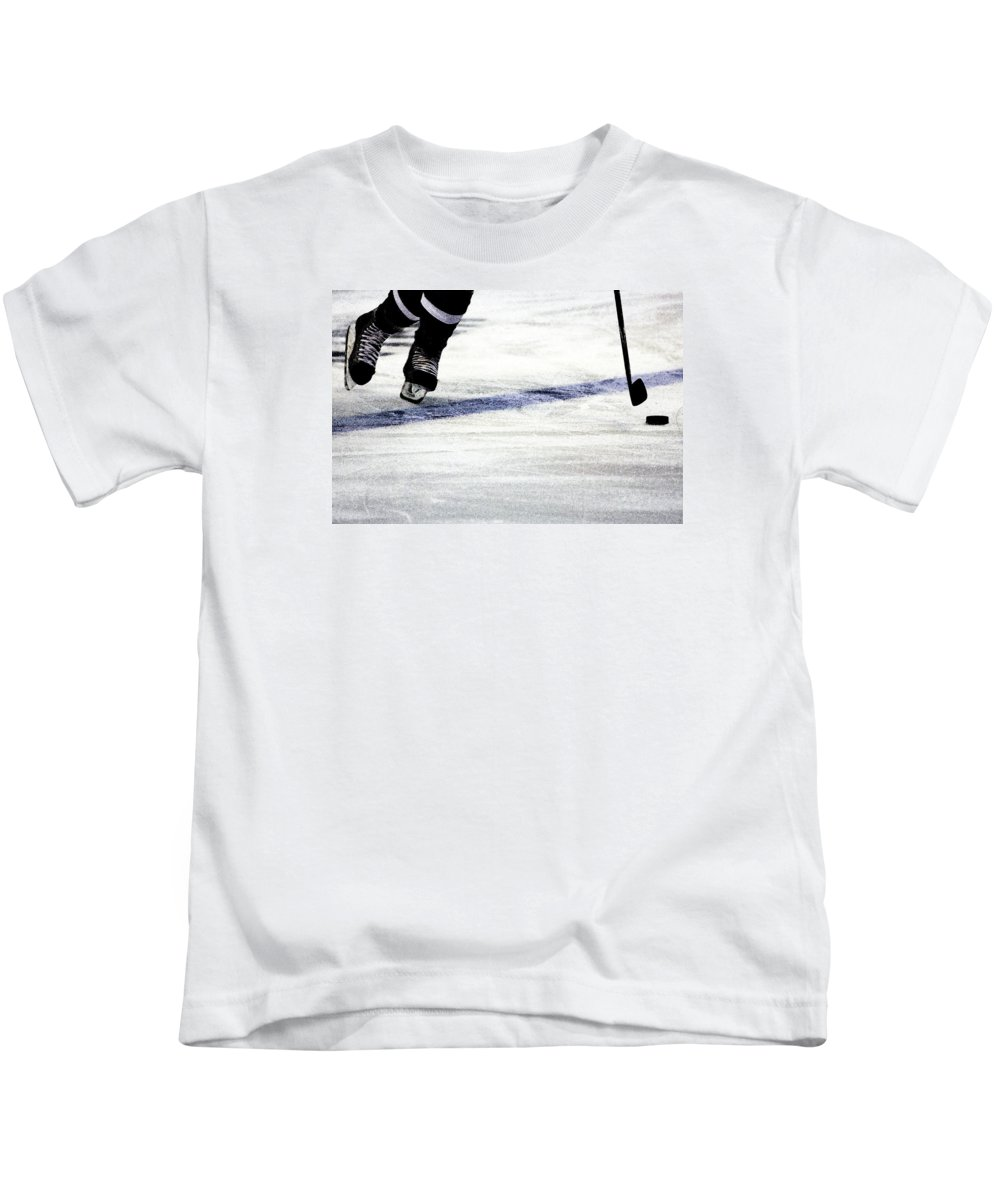 Hockey Kids T-Shirt featuring the photograph He Skates by Karol Livote