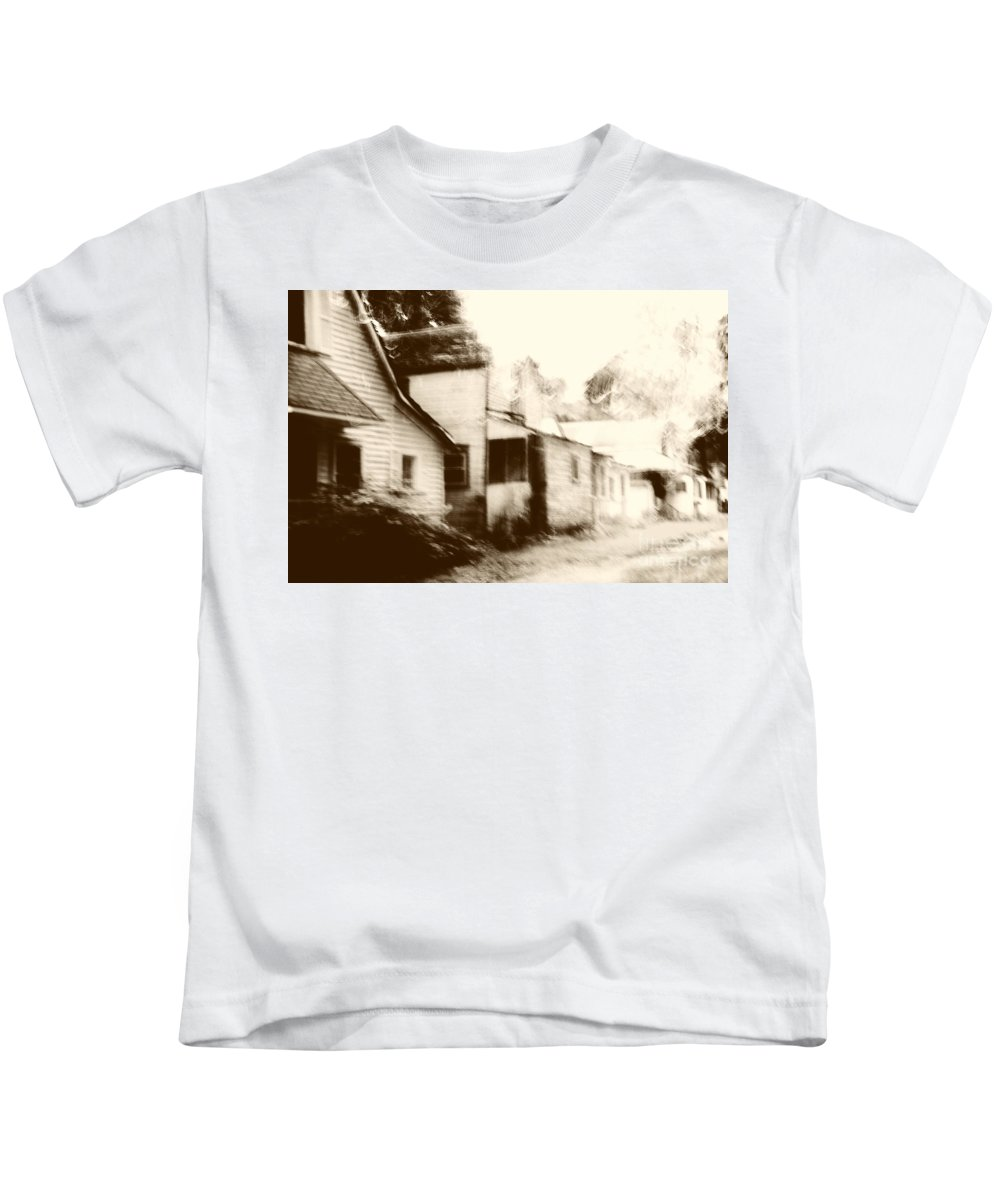 Houses; Homes; Row; Street; Road; Town; Village; Clapboard; Sepia; Old; Vintage; Bushes; Blur; Blurred; Blurry; Neighborhood; Abstract Kids T-Shirt featuring the photograph Old Neighborhood by Margie Hurwich