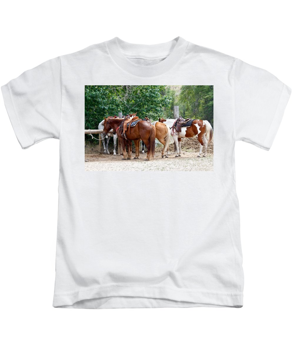 Horses Kids T-Shirt featuring the photograph Saddled by Athena Mckinzie