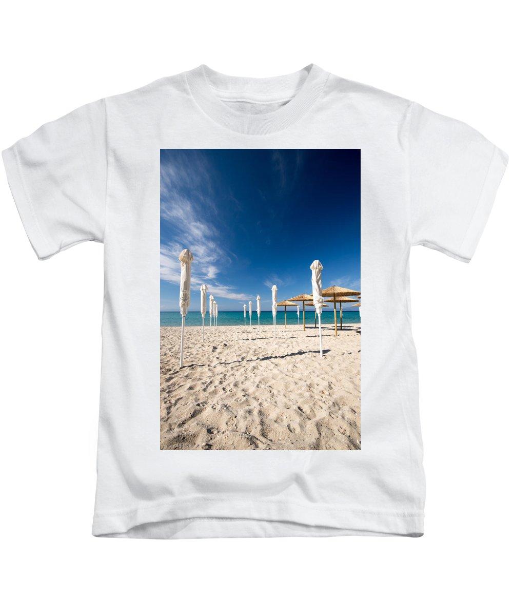 Art Kids T-Shirt featuring the photograph Sandy Beach Umbrellas by Roy Pedersen