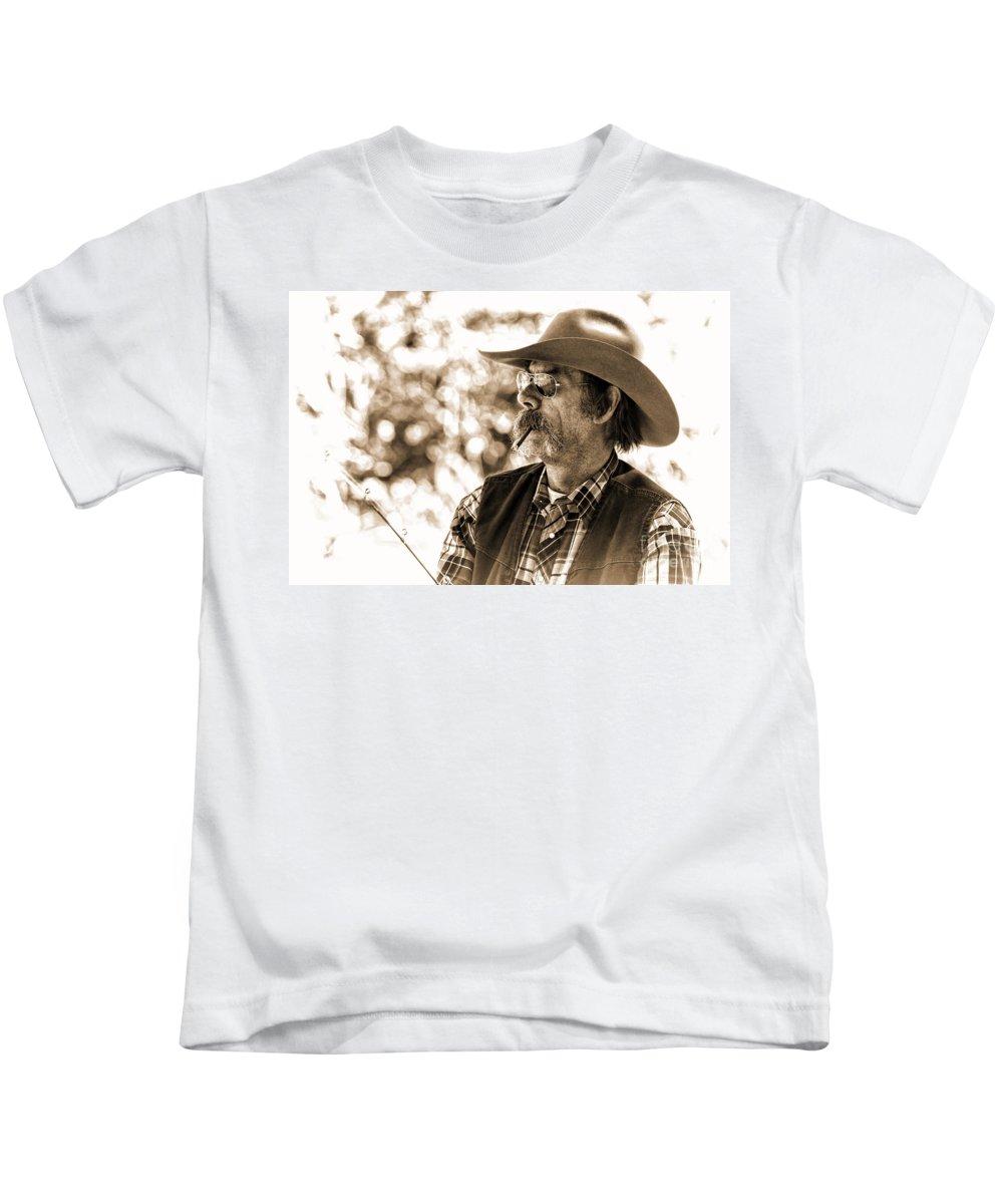 Cowboy Fisherman Kids T-Shirt featuring the photograph The Cowboy Angler by Jim Garrison
