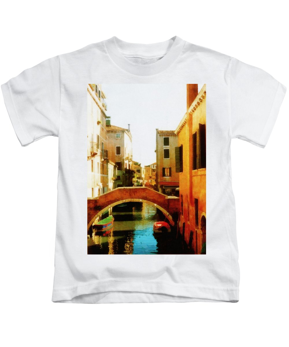 Venezia Kids T-Shirt featuring the photograph Venice Italy Canal With Boats And Laundry by Michelle Calkins