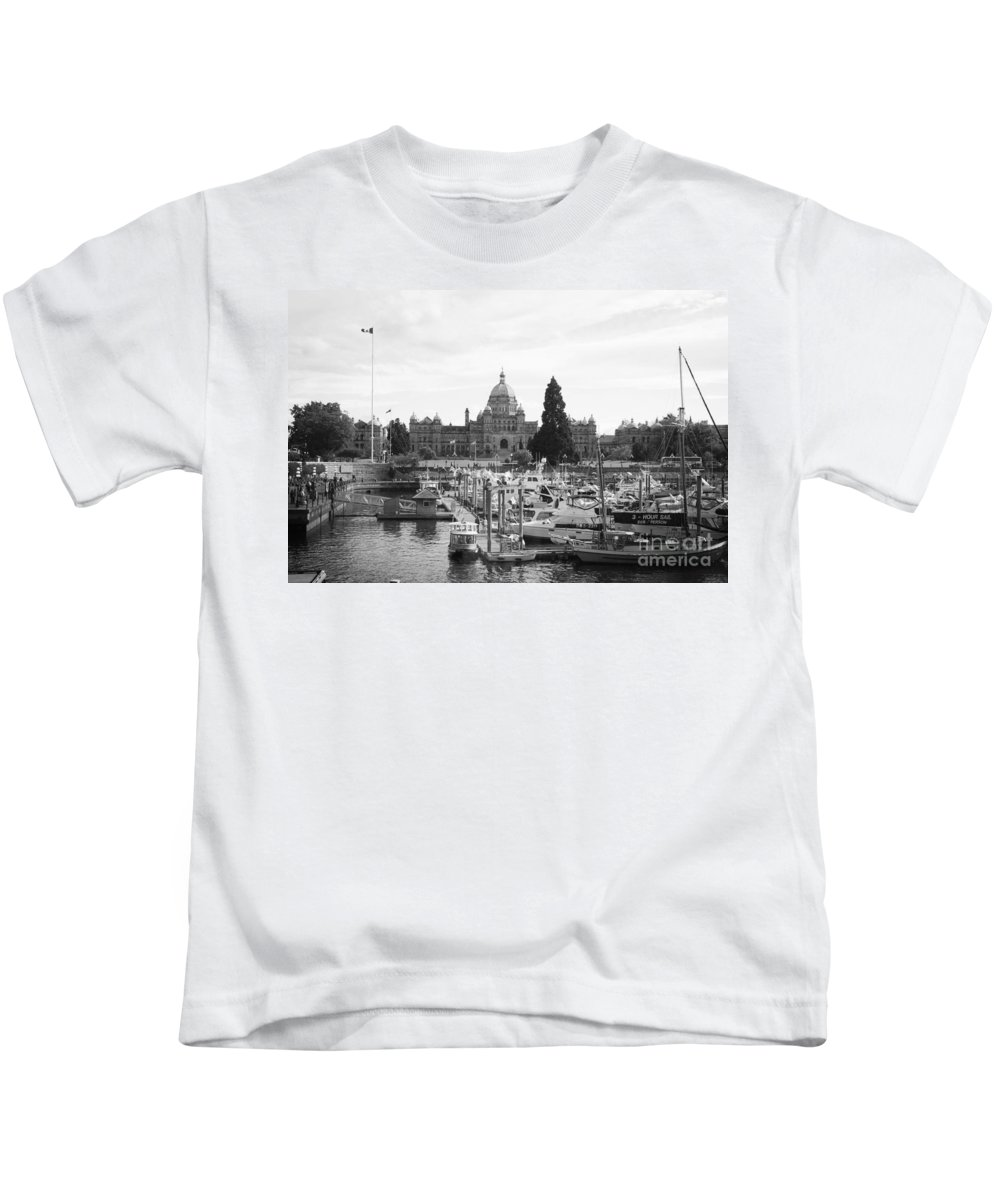 Canada Kids T-Shirt featuring the photograph Victoria Harbour With Parliament Buildings - Black And White by Carol Groenen