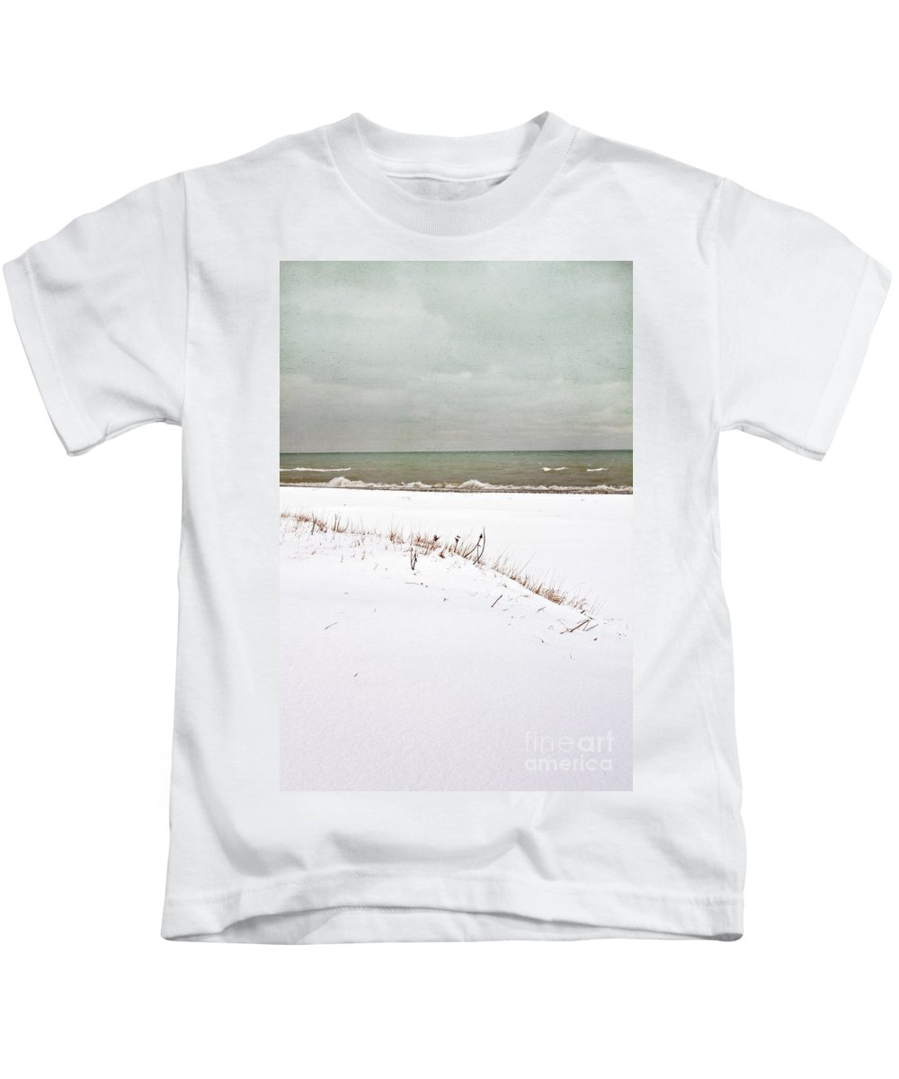 Winter; Season; Cold; Wintery; Blustery; Snow; Ground; White; Grasses; Dead; Brown; Water; Lake; Pond; Horizon; Sea; Ocean; Blue; Sky; Clouds; Cloudy; Waves; Seascape; Foam; Minimal; Beautiful; Lovely; Serene; Alone; Bay Kids T-Shirt featuring the photograph Winter Scene by Margie Hurwich
