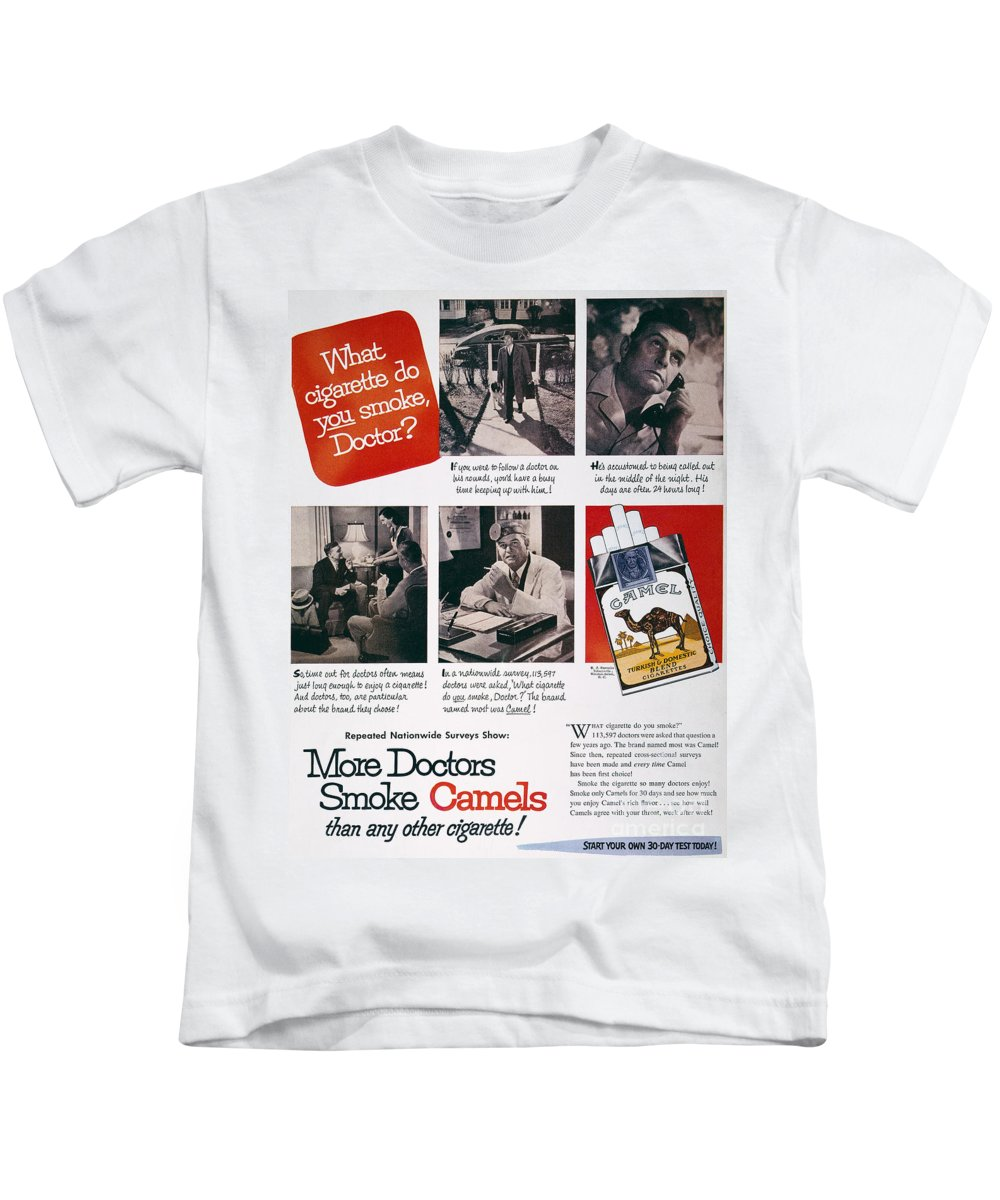 e2f9e691 1946 Kids T-Shirt featuring the photograph Camel Cigarette Ad, 1946 by  Granger