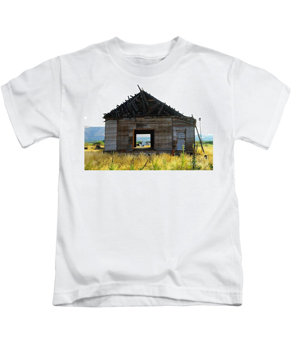 Barns Kids T-Shirt featuring the photograph An Empty Barn by Jeff Swan
