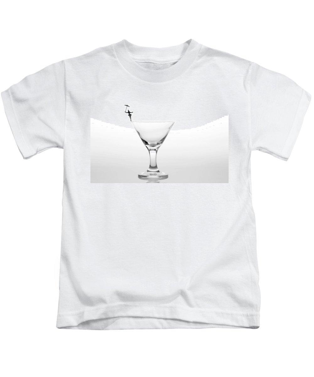 Black Kids T-Shirt featuring the photograph Circus Balance Game On Cup Edge by Paul Ge