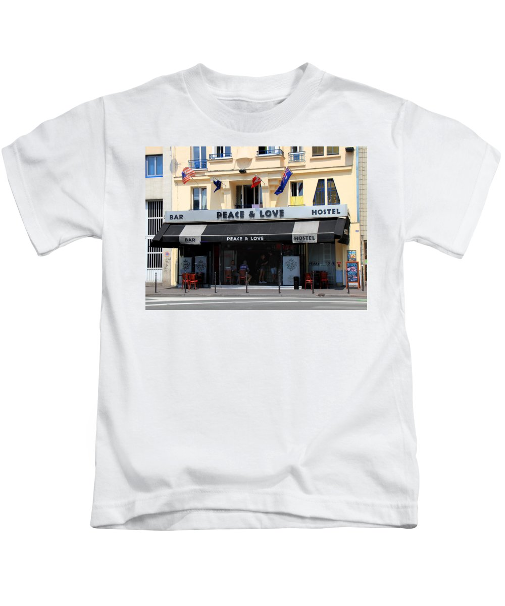 Paris Kids T-Shirt featuring the photograph Peace And Love Hostel by Andrew Fare