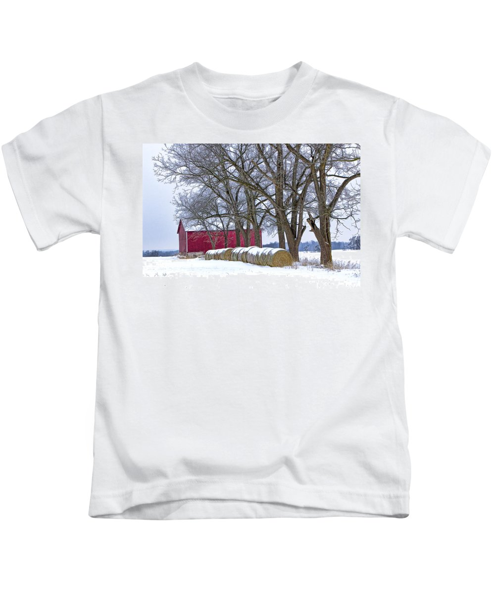 Art Kids T-Shirt featuring the photograph Red Barn In Winter With Hay Bales by Randall Nyhof