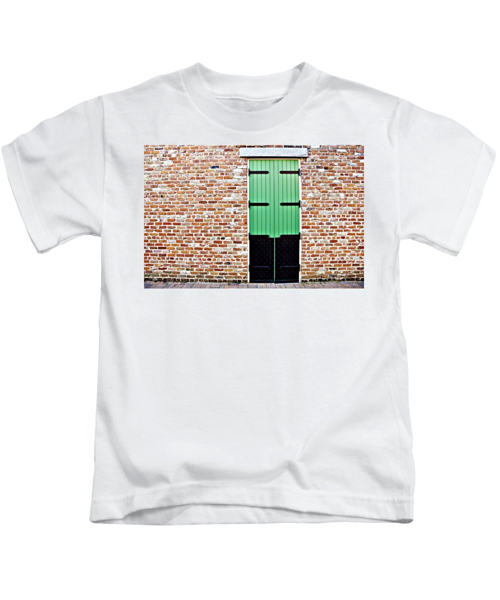 Architecture Kids T-Shirt featuring the photograph Red Bricks, Green Door by Ray Laskowitz
