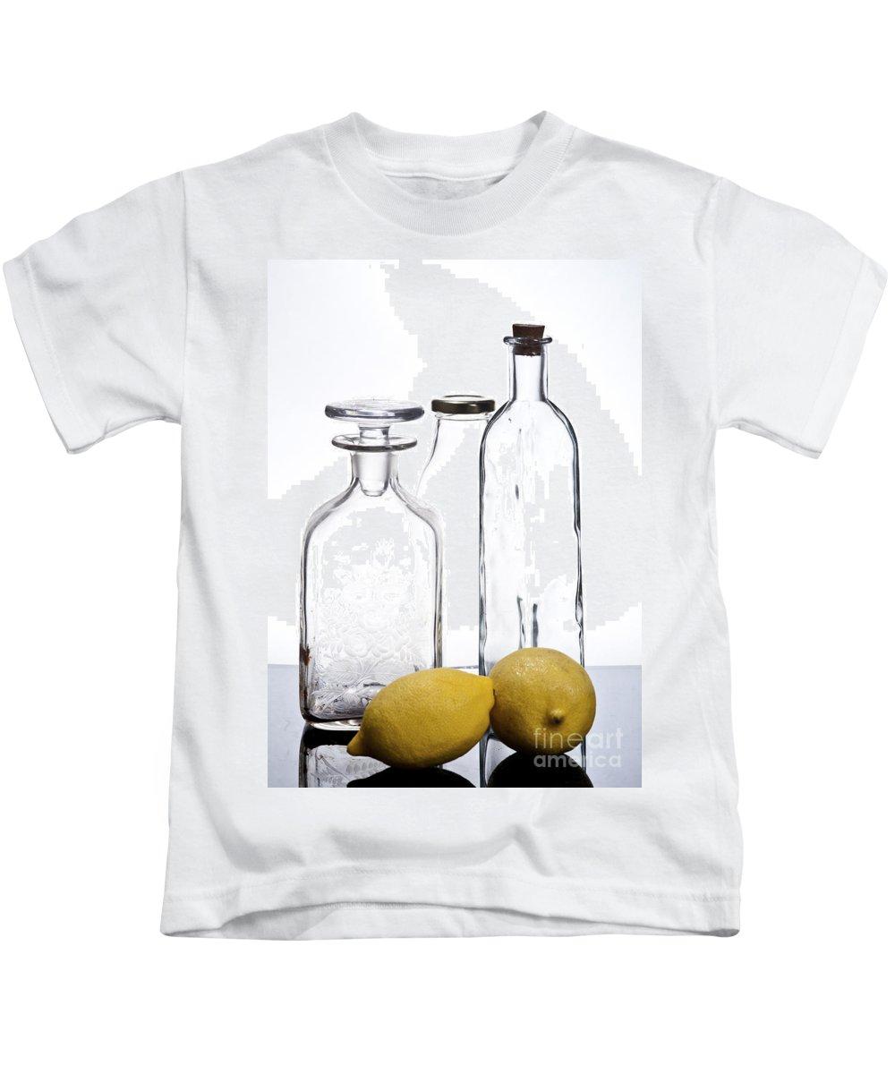 Assortment Kids T-Shirt featuring the photograph Still Life Of Bottles And Lemons by Ilan Amihai