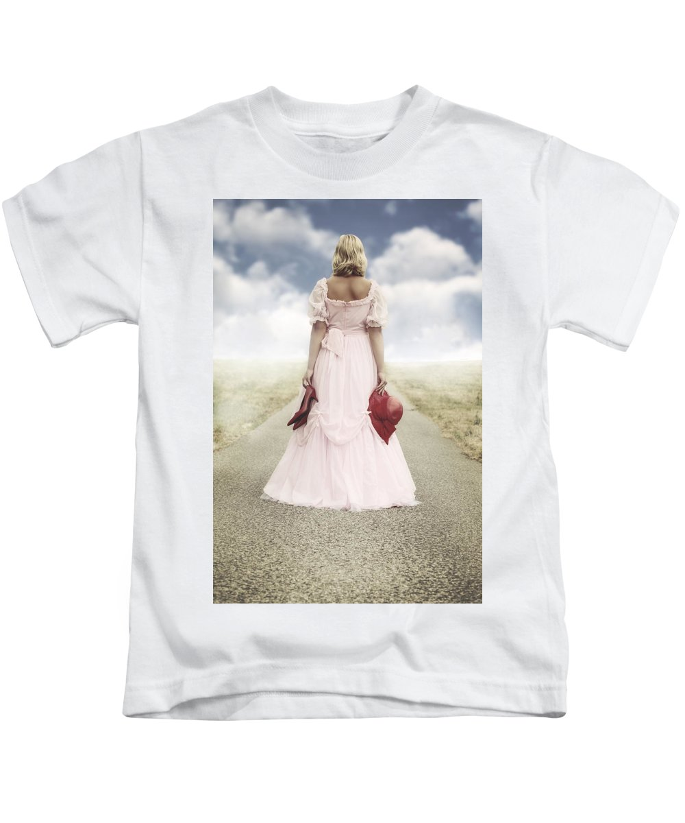 Female Kids T-Shirt featuring the photograph Woman On A Street by Joana Kruse