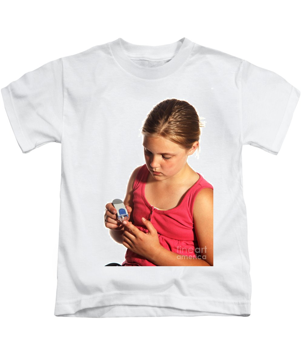 Child Kids T-Shirt featuring the photograph Diabetic Child With Blood Glucose Tester by Ted Kinsman