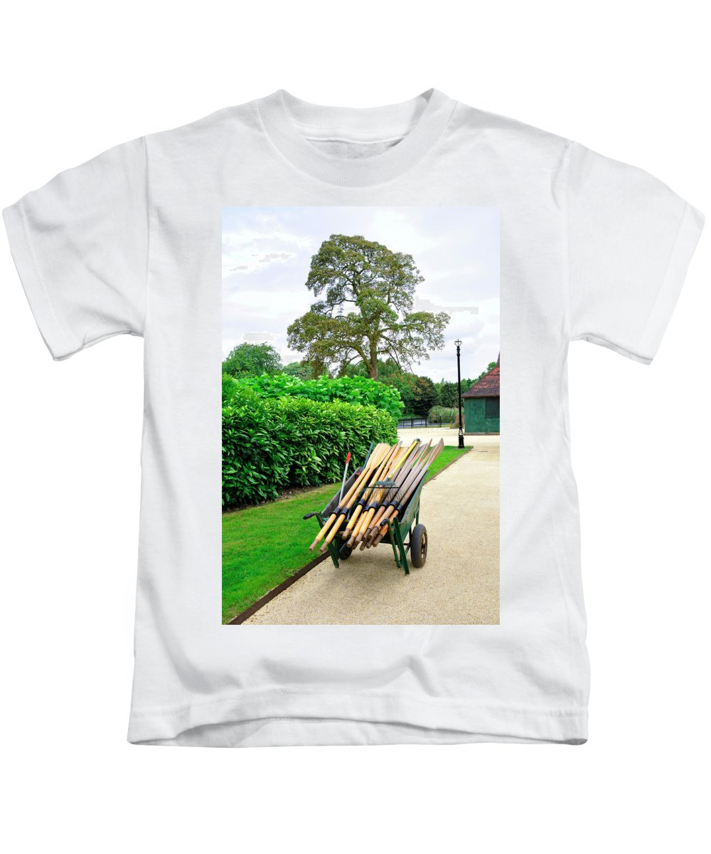 Laurel Kids T-Shirt featuring the photograph A Barrow Load Of Oars by Rod Johnson