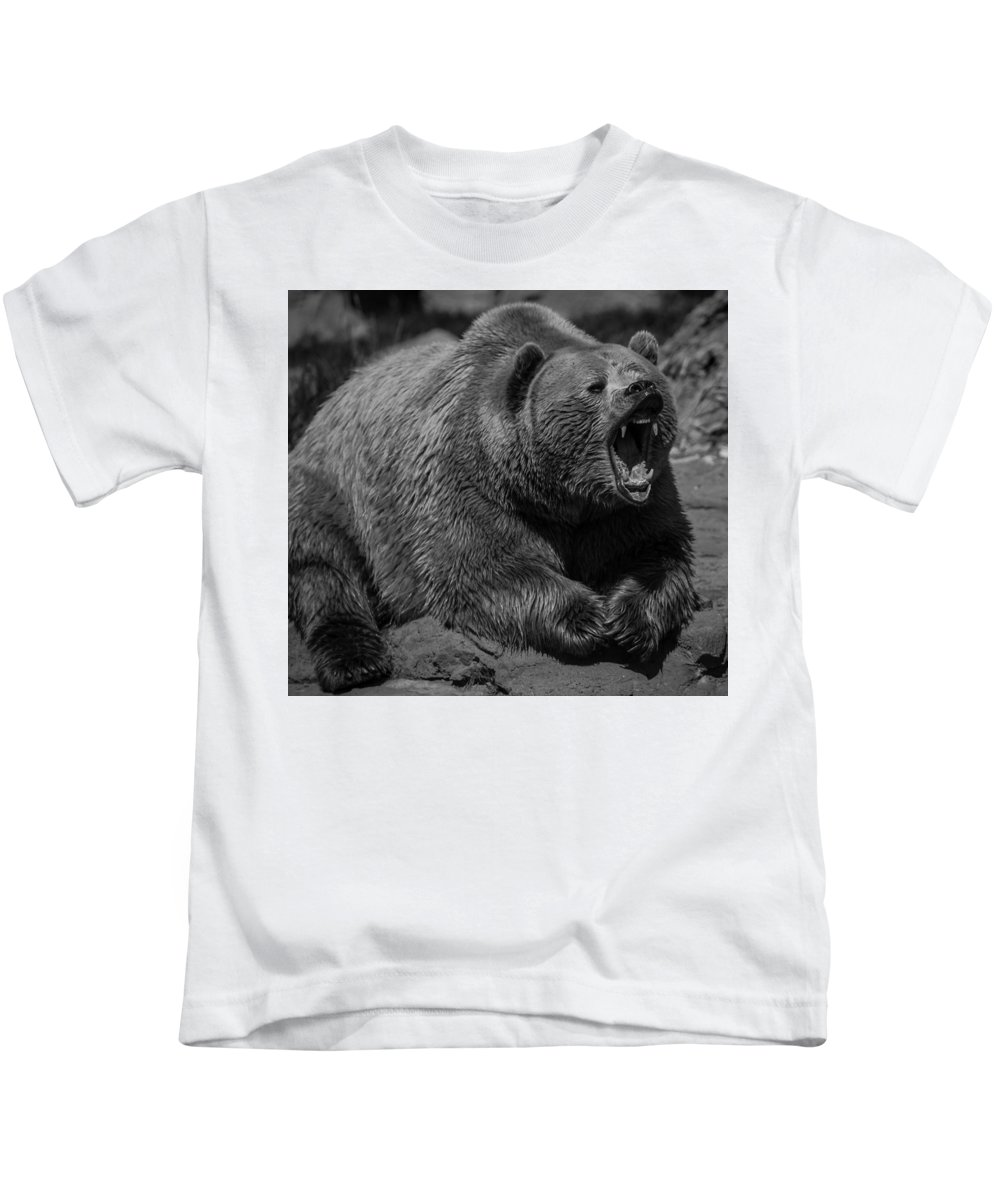 Yellowstone National Park Kids T-Shirt featuring the photograph A Slightly Upset Grizzly Bear by Jason Moynihan