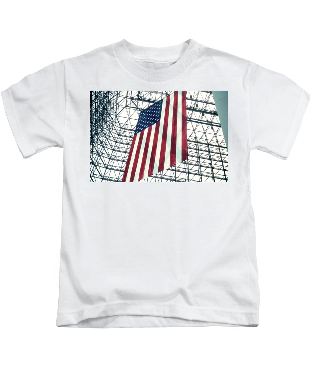 Flag Kids T-Shirt featuring the photograph American Flag In Kennedy Library Atrium - 1982 by Thomas Marchessault