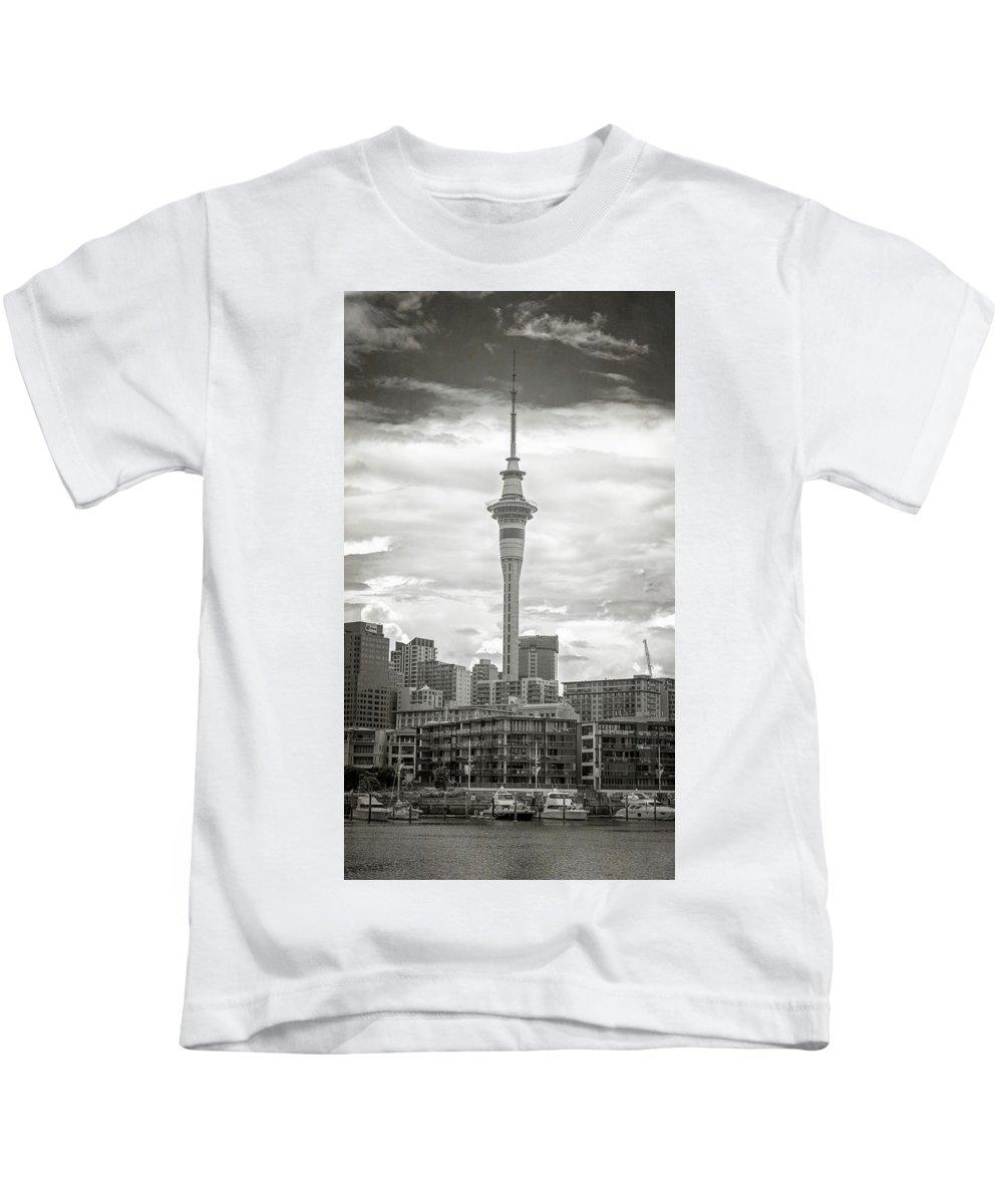 Joan Carroll Kids T-Shirt featuring the photograph Auckland New Zealand Sky Tower Bw Texture by Joan Carroll
