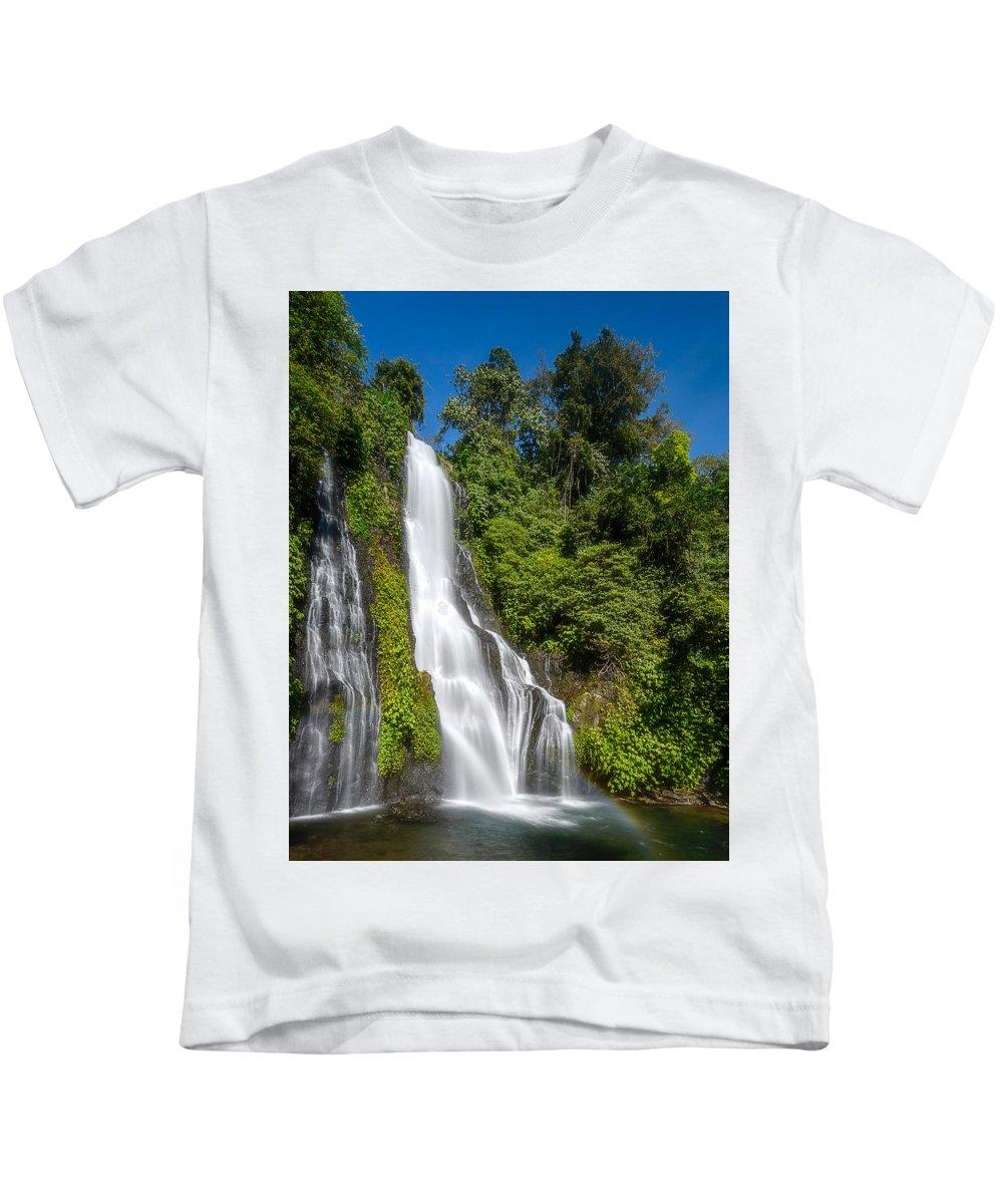 #waterfall #green #water #fresh #landscape #bluesky #sky Kids T-Shirt featuring the photograph Banyumala Waterfall by Sugianto Art Photography