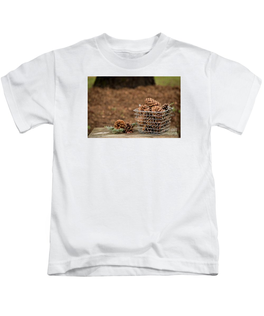 Pine Cones Kids T-Shirt featuring the photograph Basket Of Cones by Kelly Ann Jones