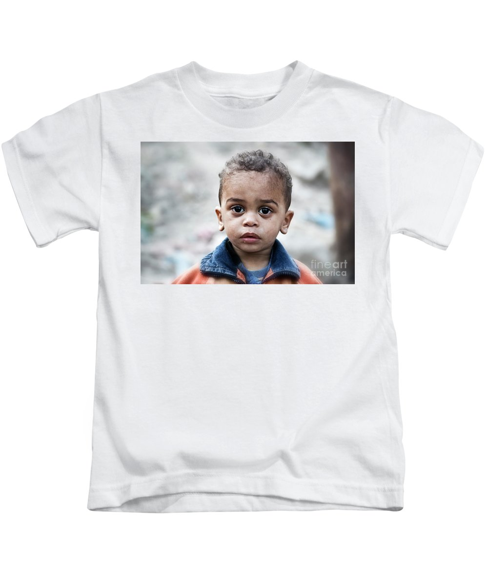 Child Kids T-Shirt featuring the photograph Boy by Charuhas Images