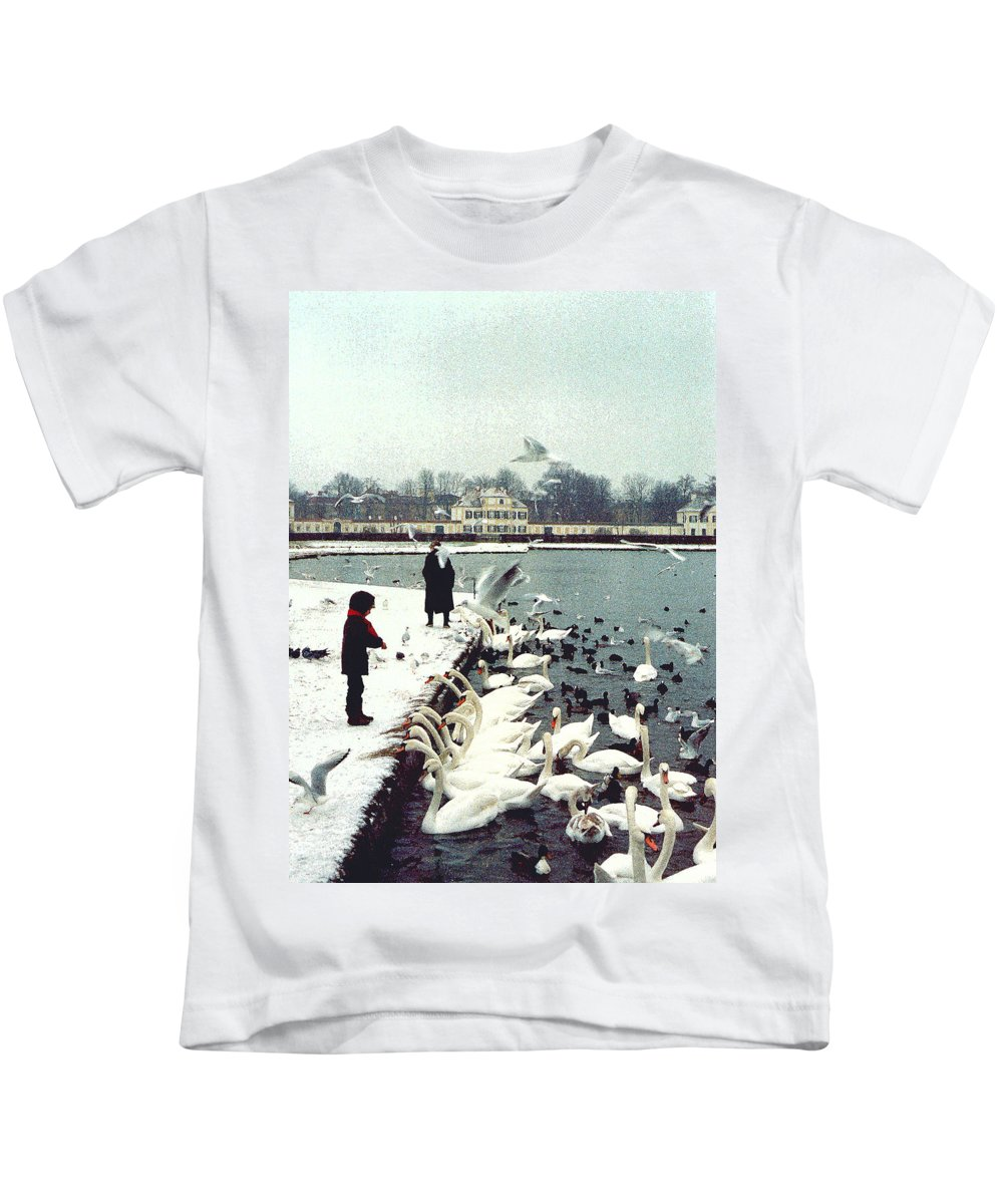 Swans Kids T-Shirt featuring the photograph Boy Feeding Swans- Germany by Nancy Mueller