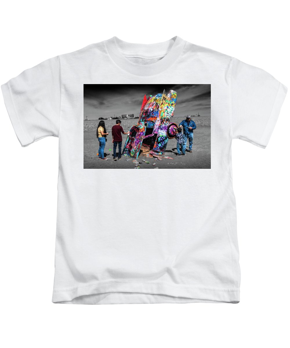 Landmark Kids T-Shirt featuring the photograph Cadillac Ranch Spray Paint Fun Along Historic Route 66 By Amarillo Texas by Randall Nyhof