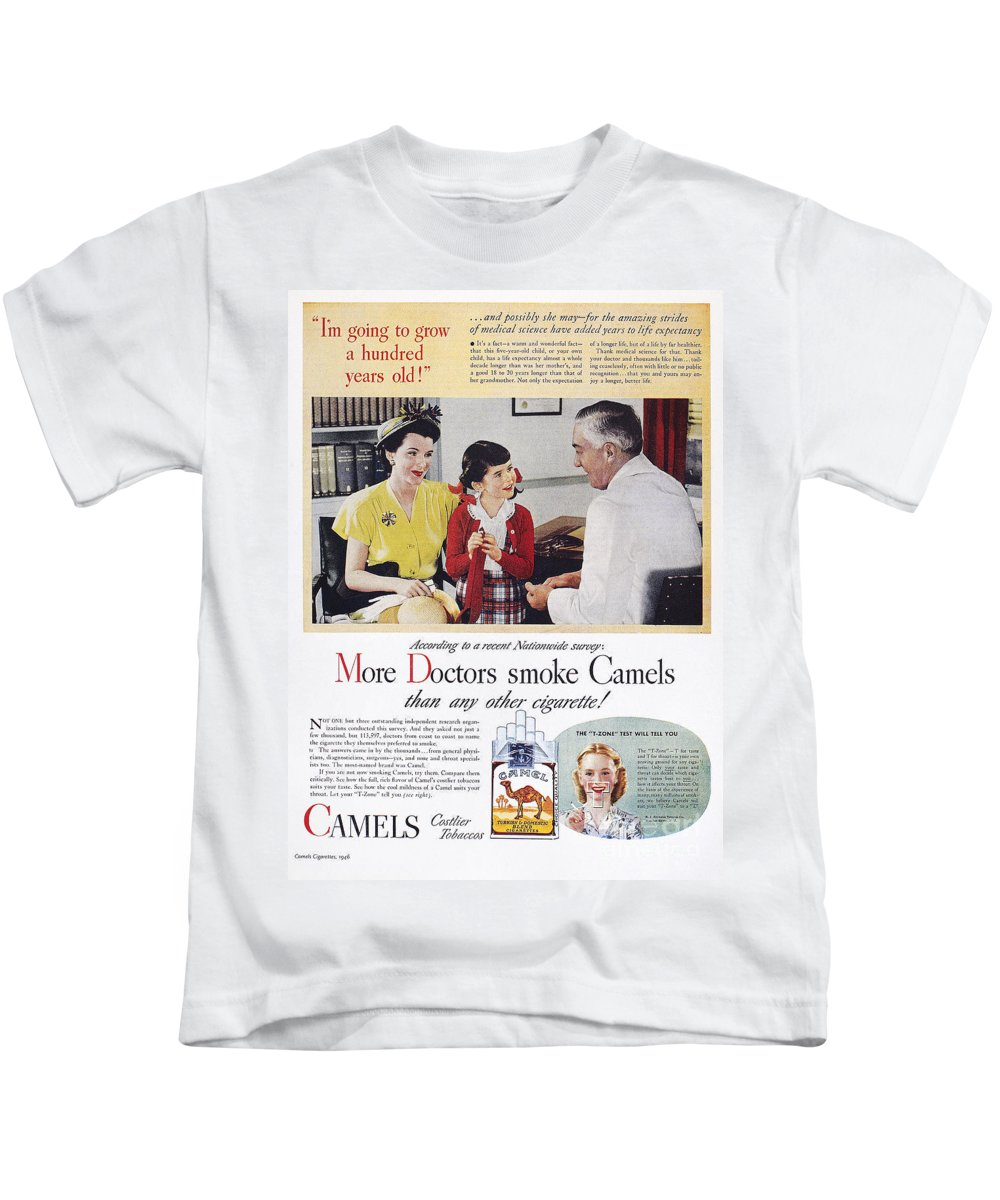 1946 Kids T-Shirt featuring the photograph Camel Cigarette Ad, 1946 by  Granger