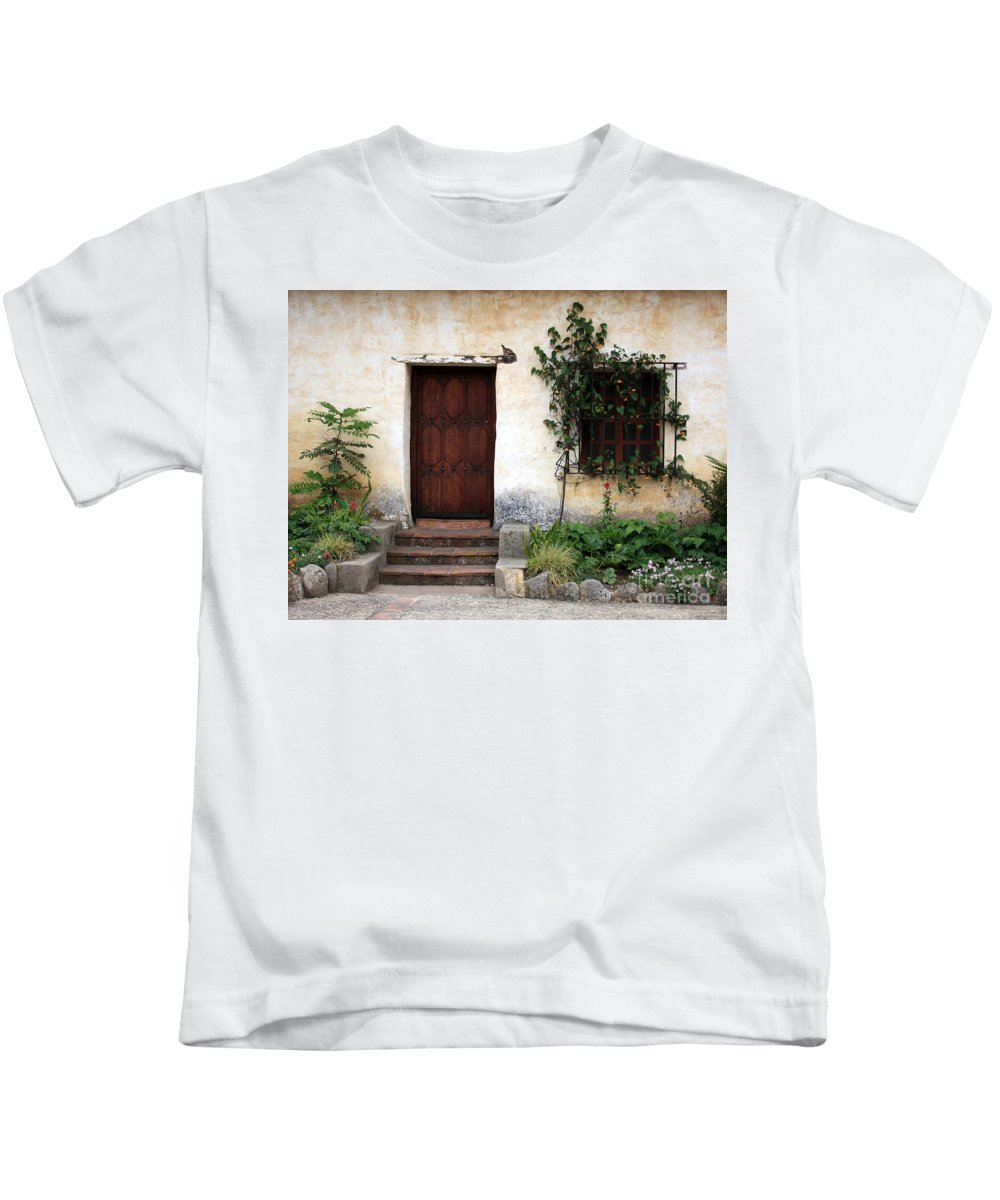 Carmel Mission Kids T-Shirt featuring the photograph Carmel Mission Door by Carol Groenen