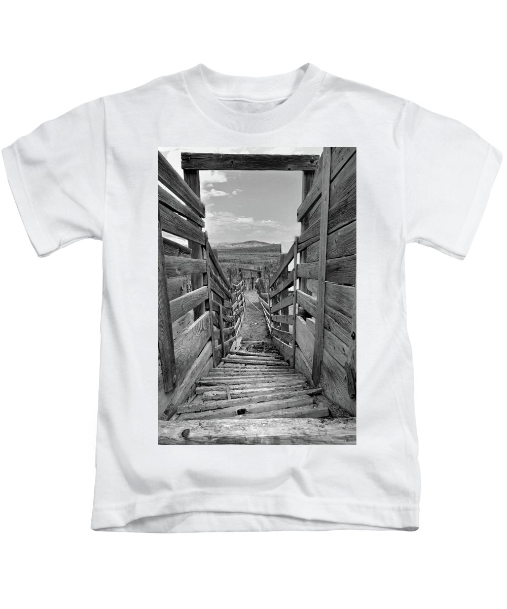 Nevada Kids T-Shirt featuring the photograph Cattle Chute by Jeff Brunton